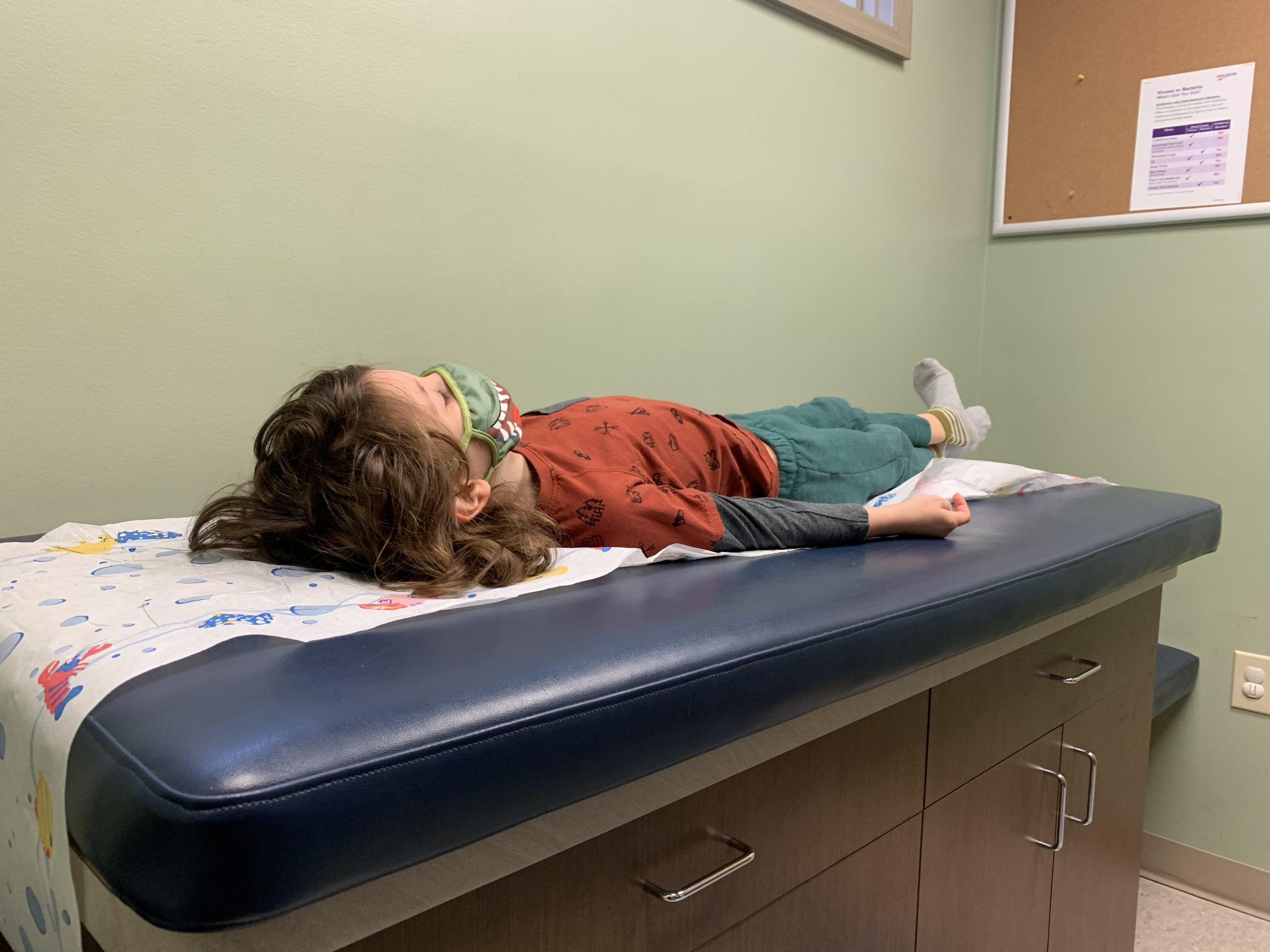 Griffin lying on the examination table at his pediatrician.